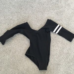 Black dance leotard with pink stripe arm